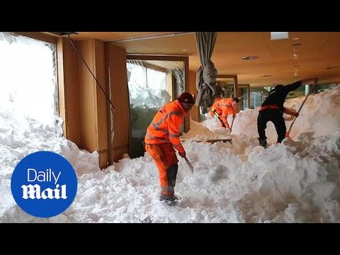 Rescue workers shovel snow out of restaurant after avalanche
