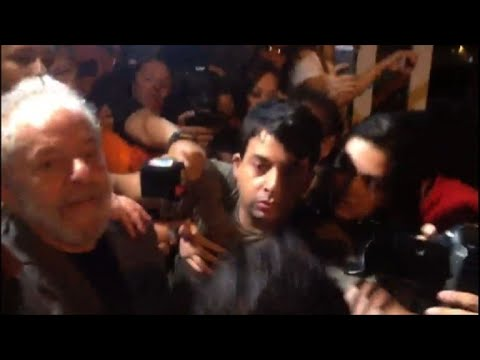 Brazil's Lula pushes through crowd before surrendering to police