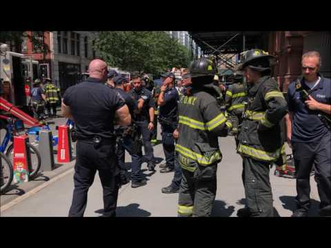 FDNY, NYPD & EMS PERSONNEL ON SCENE OF UNUSUAL RESCUE BOX WHERE A MAN WAS PINNED UNDER A ELEVATOR.
