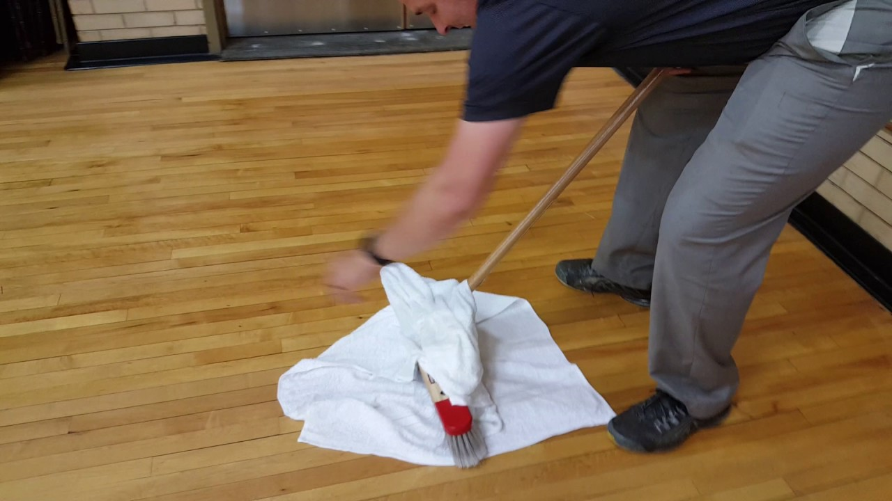 wood floor tacking after prep before floor finish water and clean bath towels with push broom