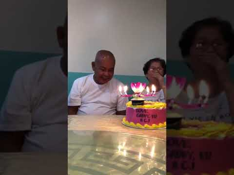 Grandma Startled At Blooming Flower Birthday Candle
