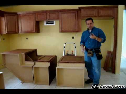 How To Install Base Cabinets (Part 1 of 4).wmv - YouTube How Long To Install Kitchen Cabinets on installing wall cabinets, corner to install kitchen cabinets, how design kitchen cabinets, install toe kick cabinets, installing corner cabinets, applying crown molding to cabinets, install crown molding kitchen cabinets,