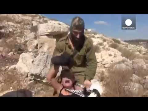 Palestinian women and children fight off Israeli s