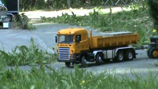Scania 460 mit O&K Bagger