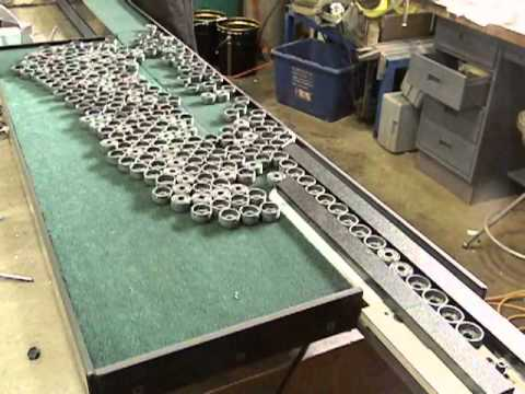 Vibratory Conveyor With In Line Buffer Table Youtube