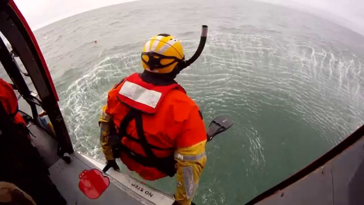 US Coast Guard Rescue Swimmers Jumping from a helicopter - YouTube