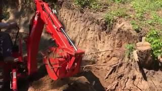 2017 Kubota B 2601 Removing a stump with a backhoe