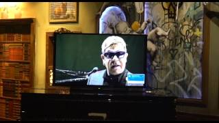 Watch Elton playing the opening party (remotely)