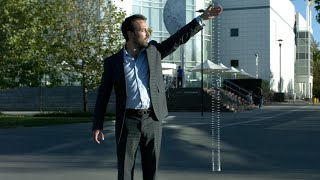 Does a Falling Slinky Defy Gravity?
