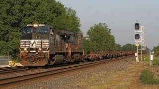Pacing Norfolk Southern #9531 Down Old Route 36 at Buffalo Illinois.
