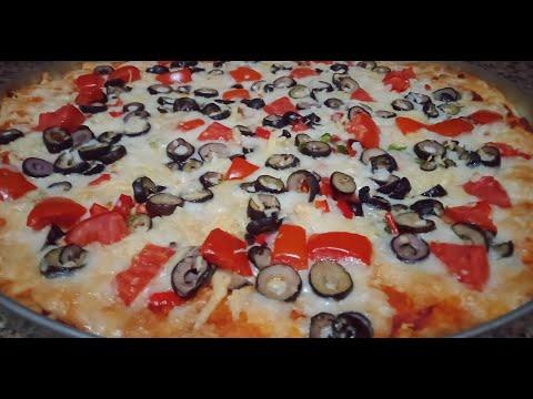 صورة  طريقة عمل البيتزا طريقه عمل بيتزا بالجبنه الموتزريلا زاي المحلات طريقة عمل البيتزا من يوتيوب