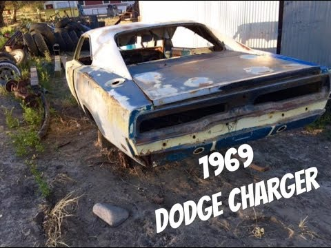 One mans junk is another mans treasure...1969 Dodge charger shell pulled from a farm.
