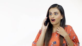 Young pretty girl standing against a white background while answering a personal phone call