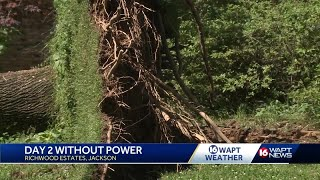 Some neighborhoods still without power after storms