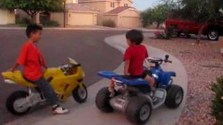 Repeat youtube video Motorcycle (4 year old on ATV 12 volts versus 7 year old on Motorcycle 36 volts)