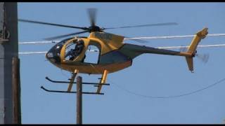 Helicopter tows a transmission line