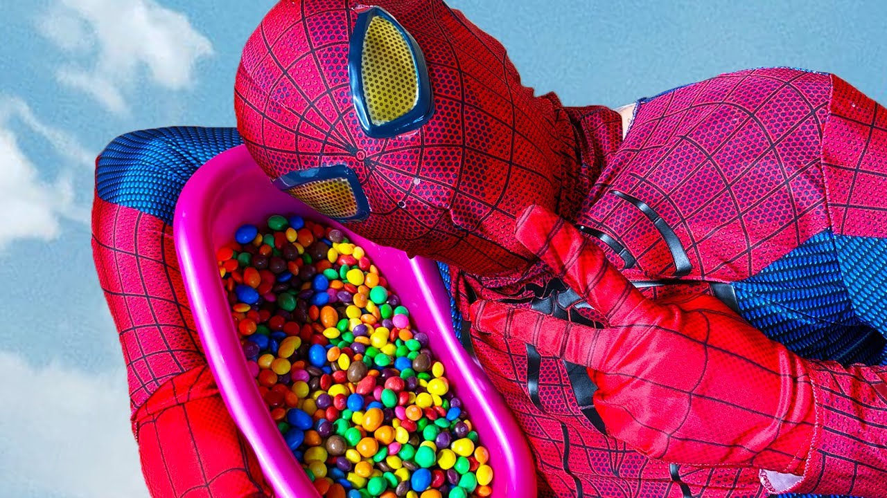 Spider Man Popping Balloons with Magic M&M's and Skittles