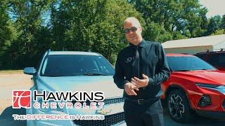 Hawkins Chevy. Salesman in Black Selling Your Car