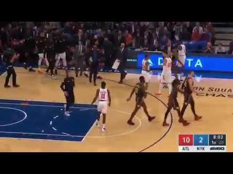 Fan make Knicks first shot of the season after the Knicks start 0/9. He shot from halfbcourt for 10k