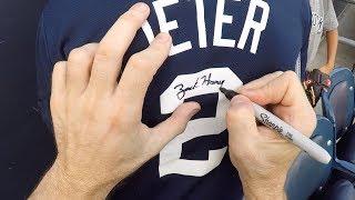 Signing a Derek Jeter t-shirt at Yankee Stadium