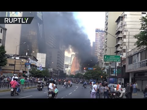 Mass evacuation in Caracas as anti-govt protesters attack court with petrol bombs