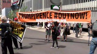 Demonstrators in downtown Tulsa before Trump rally