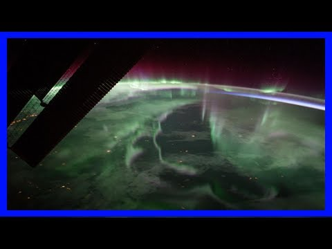 Breaking News   Image: northern lights over canada from the iss