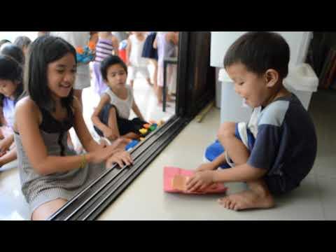 Slum children in Guadalupe, Cebu, learn simple magic tricks.