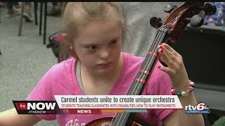 WATCH: Carmel High School students help classmates with special needs make beautiful music