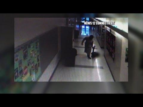 Video: Principal drags kids down school hallway