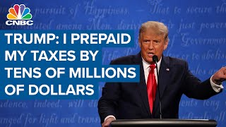 President Donald Trump says he prepaid his taxes by tens of millions of dollars