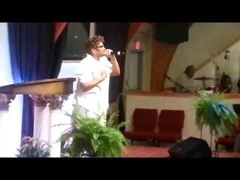 Sister Debra sings gospel song.