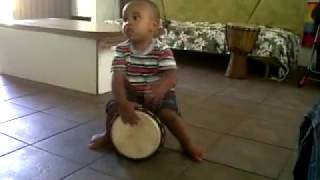 my 2yr old making dhikr with drum
