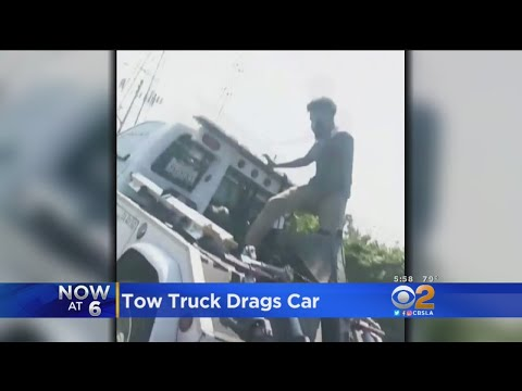 Tow Truck Drags Car