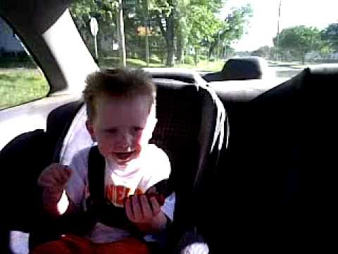 Kid dancing in car