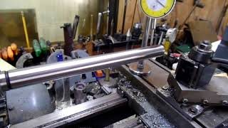 Using a test bar to align the headstock on my lathe.