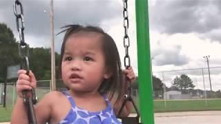 Cute Asian toddler swinging!