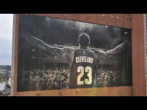 Watch as the LeBron James banner is re-installed with a gold championship patch