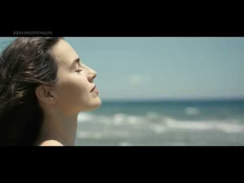 Melia Kreiling, feet, sand and waves in Committed 2014