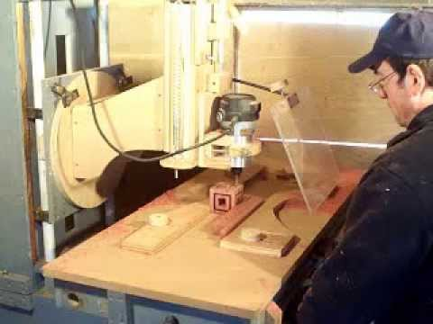 Router Wood Milling Machine Cutting Out A Cube Within A