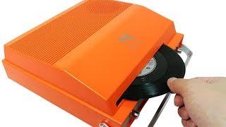 "MPK Slot-Loading 7"" record player: The bright orange record eater"
