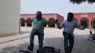 Haryanvi teachers dancing in female style.