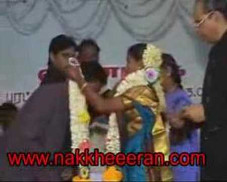 Tamil Marriage hugging bride and kissing
