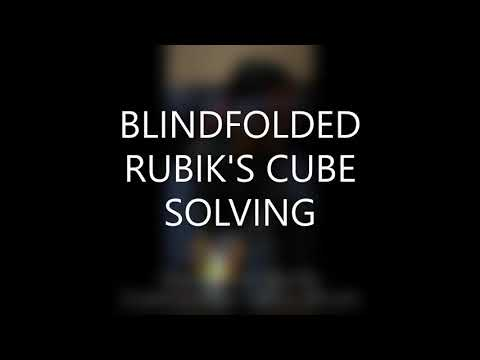 Blindfolded Rubik's cube solving in less than one minute by 7 years little boy