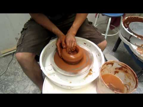 Andrew throws a bowl for Empty Bowls