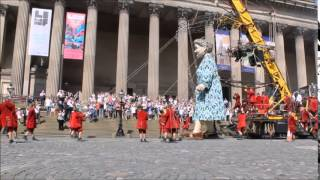 Royal De Luxe's grandmother giant walking in front of Liverpool's St. George's Hall