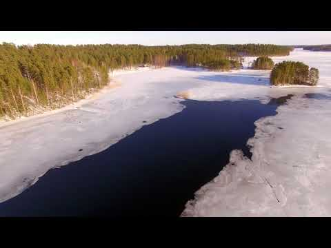 Drone above Ice Punkaharju Tuunaansalmi 4K Bird`s Eye view