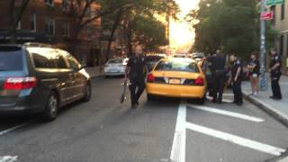 ELUSIVE NYPD YELLOW TAXI CAB & IT'S OFFICERS ARRESTING PERSON IN THE WEST VILLAGE OF MANHATTAN, NYC.