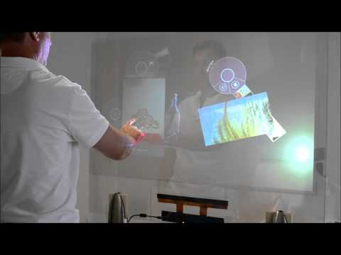Transform glass in a multi-touch experience using a rear projection holographic film