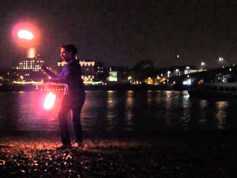 Admiral Lisette Awesome spinning Poi on Thames River Beach - London